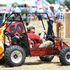 Globe/T. Rob Brown<br /> While many people drive around the Four State Farm Show in golf carts, this man is operating a gas-powered go-kart Friday morning, July 19, 2013, during the farm show near Pittsburg, Kan.