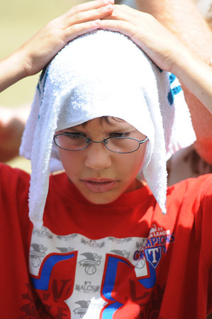 Globe/T. Rob Brown<br /> Nathan Gregory, 9, of Grapevine, Texas, keeps cool by putting an ice-cold towel atop his head Friday morning, July 19, 2013, during the Four State Farm Show near Pittsburg, Kan. The towels were being given out by Mercy.