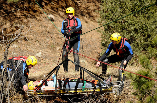 "Boulder Emergency Squad members work to rescue Brittany Odhner, 26, of Boulder, duriing a Fourmile flood training exercise on Saturday, April 16, on Poorman Road in Boulder. Odhner was being rescued as if she was an injured hiker during a flood. For more photos and video go to  <a href=""http://www.dailycamera.com"">http://www.dailycamera.com</a><br /> Jeremy Papasso/ Camera"