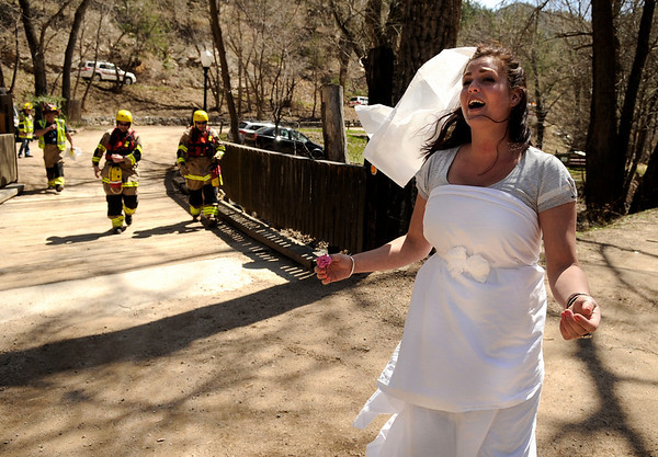 """Brittany Odhner, 26, of Boulder, acts like a distressed bride during a Fourmile flood training exercise on Saturday, April 16, at the Boulder Mountain Lodge in the Fourmile Canyon area of Boulder county. This specific exercise simulated rescuing a wedding party that was injured by a flood.<br /> For more photos and video go to  <a href=""""http://www.dailycamera.com"""">http://www.dailycamera.com</a><br /> Jeremy Papasso/ Camera"""