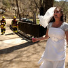 "Brittany Odhner, 26, of Boulder, acts like a distressed bride during a Fourmile flood training exercise on Saturday, April 16, at the Boulder Mountain Lodge in the Fourmile Canyon area of Boulder county. This specific exercise simulated rescuing a wedding party that was injured by a flood.<br /> For more photos and video go to  <a href=""http://www.dailycamera.com"">http://www.dailycamera.com</a><br /> Jeremy Papasso/ Camera"