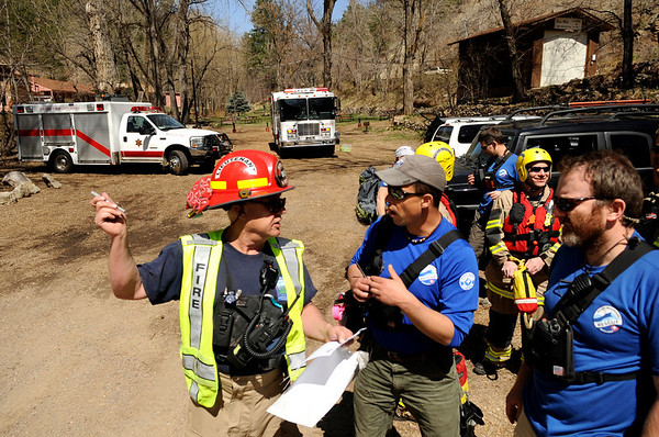 """Boulder Emergency Squad's lieutenant Grayson, left, talks with Rocky Mountain Rescue members Kevin Wheeler, center, and Pawel Osiczko during a Fourmile flood training exercise on Saturday, April 16, in the Fourmile Canyon area of Boulder county.<br /> For more photos and video go to  <a href=""""http://www.dailycamera.com"""">http://www.dailycamera.com</a><br /> Jeremy Papasso/ Camera"""