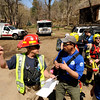"Boulder Emergency Squad's lieutenant Grayson, left, talks with Rocky Mountain Rescue members Kevin Wheeler, center, and Pawel Osiczko during a Fourmile flood training exercise on Saturday, April 16, in the Fourmile Canyon area of Boulder county.<br /> For more photos and video go to  <a href=""http://www.dailycamera.com"">http://www.dailycamera.com</a><br /> Jeremy Papasso/ Camera"