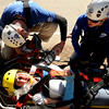"Rocky Mountain Rescue members Erin Dillard, right, and Kevin Vranes work to treat Brittany Odhner during a Fourmile flood training exercise on Saturday, April 16, on Poorman Road in Boulder. Odhner was acting as an injured hiker.<br /> For more photos and video go to  <a href=""http://www.dailycamera.com"">http://www.dailycamera.com</a><br /> Jeremy Papasso/ Camera"