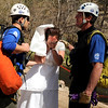 "Brittany Odhner, 26, of Boulder, acts as a distressed bride during a Fourmile flood training exercise on Saturday, April 16, at the Boulder Mountain Lodge in the Fourmile Canyon area of Boulder county.<br /> For more photos and video go to  <a href=""http://www.dailycamera.com"">http://www.dailycamera.com</a><br /> Jeremy Papasso/ Camera"