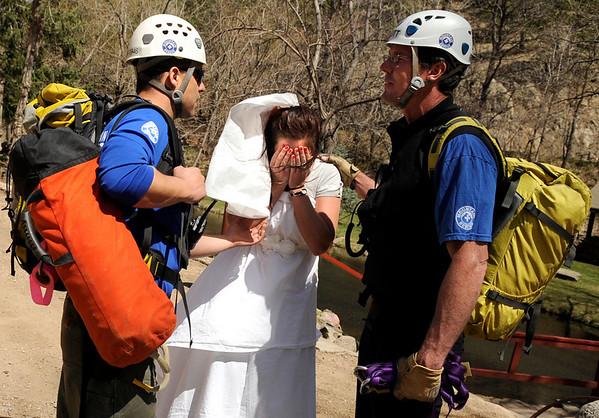 """Brittany Odhner, 26, of Boulder, acts as a distressed bride during a Fourmile flood training exercise on Saturday, April 16, at the Boulder Mountain Lodge in the Fourmile Canyon area of Boulder county.<br /> For more photos and video go to  <a href=""""http://www.dailycamera.com"""">http://www.dailycamera.com</a><br /> Jeremy Papasso/ Camera"""