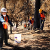 "Allison Hamm, of Lafayette, spreads some plant seeds on Saturday, March 19, during a volunteer seeding effort on Salina Mountain Rd. in the Fourmile Canyon area of Boulder. The volunteers are trying to re-grow the burned vegetation in the area caused by the Fourmile Canyon wildfire. For more photos go to  <a href=""http://www.dailycamera.com"">http://www.dailycamera.com</a><br /> Jeremy Papasso/ Camera"