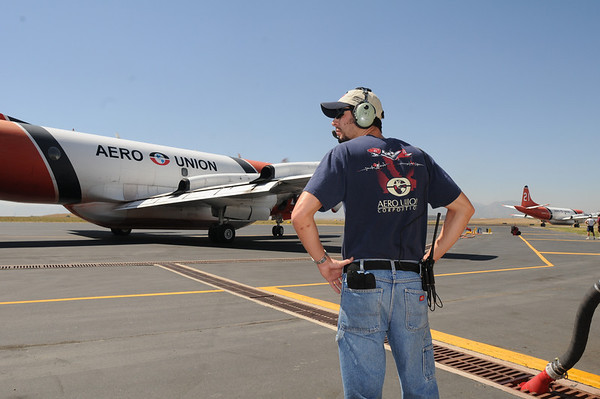 P-3, number 25, crew chief Clint Keyte watches airtankers preparing to fight the Four Mile Canyon Fire from the US Forest Service Airtanker base at Rocky Mountain Metro Airport Tuesday. <br /> <br /> September 7, 2010<br /> staff photo/David R. Jennings
