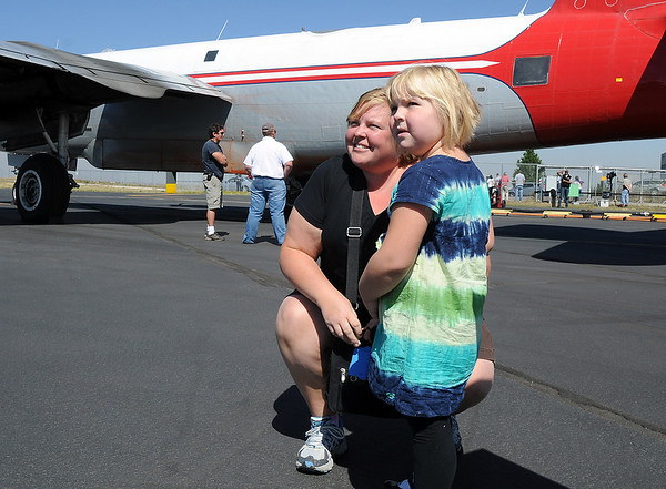 Patty Owens and her daughter MeridithKay, 5, of Arvada, look at airtankers at the US Forest Service Airtanker base at Rocky Mountain Metro Airport after bringing doughnuts, on MeridithKay's birthday, for the crews at the base before the planes started fighting the Four Mile fire in Boulder County on Tuesday. <br /> <br /> September 7, 2010<br /> staff photo/David R. Jennings