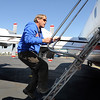 Co-pilot Jeff Sheftal climbs into his P-3 airtanker while preparing to fight the Four Mile Canyon Fire at the US Forest Service Airtanker base at Rocky Mountain Metro Airport  on Tuesday. <br /> <br /> September 7, 2010<br /> staff photo/David R. Jennings
