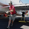 Retardant loading crew member Steve Wood US Forest Service Airtanker base at Rocky Mountain Metro Airport pit moves the filler hose away from a P-2V airtanker after filling the aircraft with fire retardant to fight the Four Mile Canyon Fire in Boulder County on Tuesday. <br /> <br /> September 7, 2010<br /> staff photo/David R. Jennings