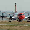 An airtanker lands while another taxies to the US Forest Service Airtanker base at Rocky Mountain Metro Airport to be filled with fire retardant to fight the Four Mile fire in Boulder County on Tuesday. <br /> <br /> September 7, 2010<br /> staff photo/David R. Jennings