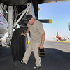 Pilot Bob Webb removes the chalks for the wheel of his P-2V airtanker at the US Forest Service Airtanker base at Rocky Mountain Metro Airport while preparing to fight the Four Mile fire in Boulder County on Tuesday. <br /> <br /> September 7, 2010<br /> staff photo/David R. Jennings
