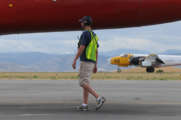 Ramp manager Robby Cline waits to direct airtankers  on the ramp of the US Forest Service Airtanker base at Rocky Mountain Metro Airport as they fight the Fourmile Canyon Fire in Boulder County on Wednesday. <br /> <br /> September 8, 2010<br /> staff photo/David R. Jennings