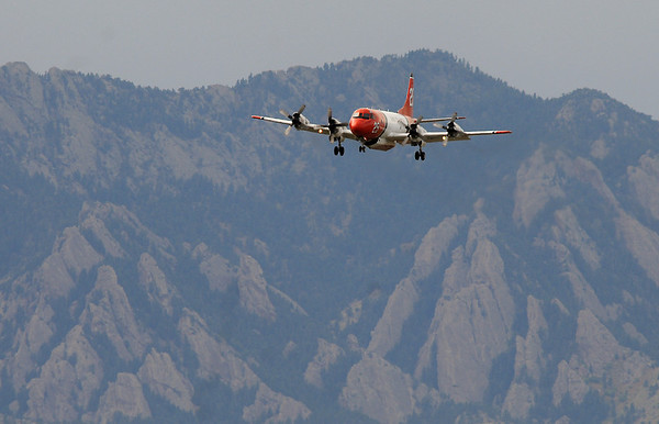 An airtanker returns to the US Forest Service Airtanker base at Rocky Mountain Metro Airport after dropping fire retardant on the Fourmile Canyon Fire in Boulder County on Wednsday. <br /> <br /> September 8, 2010<br /> staff photo/David R. Jennings