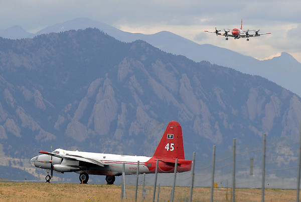 An airtanker lands while another waits to takeoff to fight the Fourmile fire in Boulder County on Wednesday at the US Forest Service Airtanker base at Rocky Mountain Metro Airport. <br /> <br /> September 8, 2010<br /> staff photo/David R. Jennings