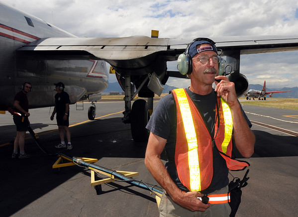 Parking Tender Mark VonAllman waits for the signal to begin filling a P-2V airtanker with retardant at the US Forest Service Airtanker base at Rocky Mountain Metro Airport on Wednesday. <br /> <br /> September 8, 2010<br /> staff photo/David R. Jennings