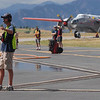 Ramp manager Robby Cline directs airtankers at US Forest Service Airtanker base at Rocky Mountain Metro Airport as they fight the Fourmile Canyon Fire in Boulder County on Wednesday. <br /> <br /> September 8, 2010<br /> staff photo/David R. Jennings