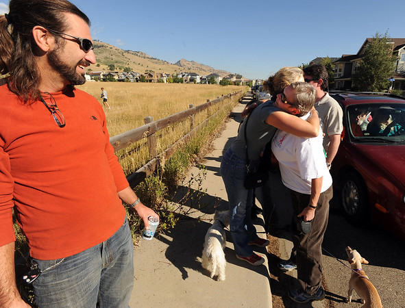 "Resident Eric May, left, watches Nancy Sissom, left, hug Bonnie Baker, as friends and neighbors wait to be able to return to their homes on September 9, 2010.<br /> For  videos  and photos relating to the fire,  go to  <a href=""http://www.dailycamera.com"">http://www.dailycamera.com</a>.<br /> Cliff Grassmick / September 9, 2010"