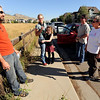 "Eric May, left, Nacy Sissom, with daughter, Grace, Brad Sissom and Bonnie Baker talk while waiting for Lee Hill Road to open for residents.<br /> For  videos  and photos relating to the fire,  go to  <a href=""http://www.dailycamera.com"">http://www.dailycamera.com</a>.<br /> Cliff Grassmick / September 9, 2010"