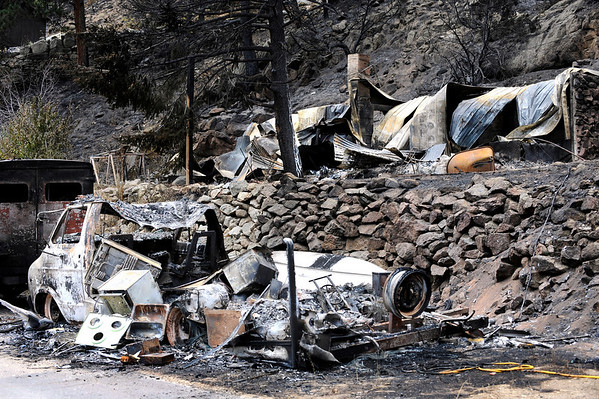 Destroyed vehicles from the Fourmile Canyon fire in Boulder, Colorado September 9, 2010.  Over 100 homes and structures have been destroyed since Monday. CAMERA/Mark Leffingwell (POOL)