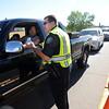 "Boulder Police Officer, Scott Adams, checks ID's of residents at the check point at 4th Street and Lee Hill Road.<br /> For  videos  and photos relating to the fire,  go to  <a href=""http://www.dailycamera.com"">http://www.dailycamera.com</a>.<br /> Cliff Grassmick / September 9, 2010"