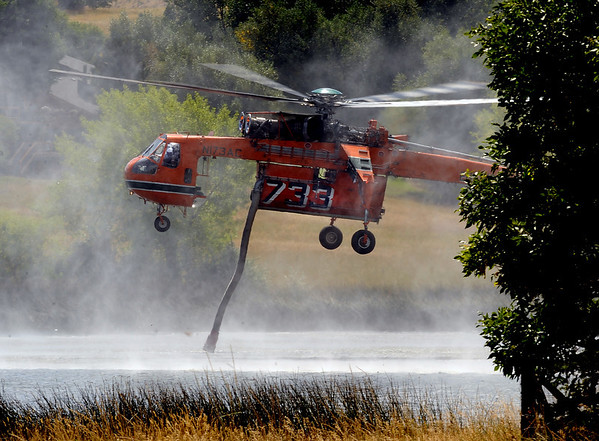 """Helicopters fighting the Fourmile Fire filled up with water at Wonderland Lake in the city of Boulder.<br /> For  videos  and photos relating to the fire,  go to  <a href=""""http://www.dailycamera.com"""">http://www.dailycamera.com</a>.<br /> Cliff Grassmick / September 9, 2010"""
