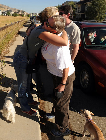 "Nancy Sissom, left, hugs Bonnie Baker, as friends and neighbors wait to be able to return to their homes on September 9, 2010.<br /> For  videos  and photos relating to the fire,  go to  <a href=""http://www.dailycamera.com"">http://www.dailycamera.com</a>.<br /> Cliff Grassmick / September 9, 2010"