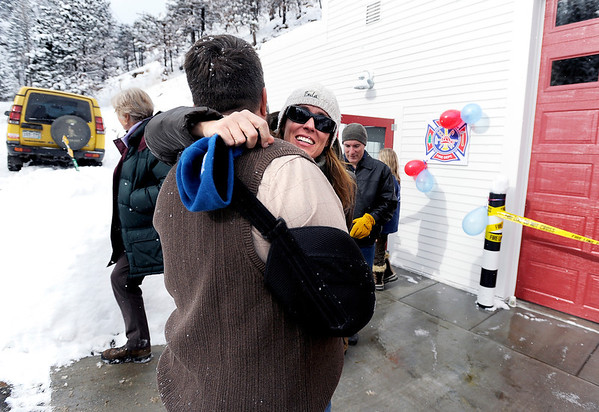 "Jennifer Melvin, of Boulder, hugs Fire Chief Bret Gibson during the opening ceremony for the new Fourmile Fire Department's Salina Fire Station on Saturday, Dec 3, in the Fourmile Canyon area of Boulder County. The fire station was destroyed in the Fourmile Canyon fire. For more photos and video of the ceremony go to  <a href=""http://www.dailycamera.com"">http://www.dailycamera.com</a><br /> Photo by Jeremy Papasso"