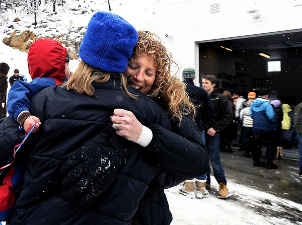 "Maria Mitchell, left, hugs Michelle Grainger during the opening ceremony for the new Fourmile Fire Department's Salina Fire Station on Saturday, Dec 3, in the Fourmile Canyon area of Boulder County. Both Mitchell and Grainger live in the Salida area. The fire station was destroyed in the Fourmile Canyon fire. For more photos and video of the ceremony go to  <a href=""http://www.dailycamera.com"">http://www.dailycamera.com</a><br /> Photo by Jeremy Papasso"