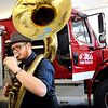 "Ben Fausch, of Boulder, plays the sousaphone in front of the new fire truck during the opening ceremony for the new Fourmile Fire Department's Salina Fire Station on Saturday, Dec 3, in the Fourmile Canyon area of Boulder County. The fire station was destroyed in the Fourmile Canyon fire. For more photos and video of the ceremony go to  <a href=""http://www.dailycamera.com"">http://www.dailycamera.com</a><br /> Photo by Jeremy Papasso"