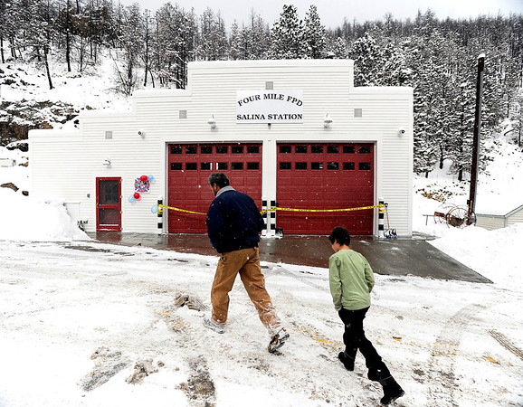 "Keith Hartnett, of Boulder, and his 9-year-old son Quinn walk towards the fire station doors during the opening ceremony for the new Fourmile Fire Department's Salina Fire Station on Saturday, Dec 3, in the Fourmile Canyon area of Boulder County. The fire station was destroyed in the Fourmile Canyon fire. For more photos and video of the ceremony go to  <a href=""http://www.dailycamera.com"">http://www.dailycamera.com</a><br /> Photo by Jeremy Papasso"