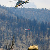 MULCH<br /> A K-Max helicopter flies with a net full of straw mulch material to deposit on the Fourmile Fire burn area on Thursday. The county project will reduce flooding threats in the most severely burned areas.<br /> Photo by Marty Caivano/April 7, 2011