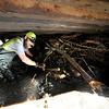 "Matt Linton with the Boulder County Road crew work to clear debris from under a bridge in Fourmile Canyon.<br /> For a video of of the Fourmile storm damage go to  <a href=""http://www.dailycamera.com"">http://www.dailycamera.com</a><br /> Photo by Paul Aiken / The Camera"