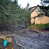 Floodwaters damage a home on Pinto Drive near the Anne U White Trailhead in Boulder<br /> Courtesy of  Frederick Blume