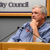 Lafayette City Council member Brad Wiesley listens as Lafayette residents express their concern about fracking within city limits during a city council meeting on Tuesday, March 5, at the Lafayette City Hall.<br /> Jeremy Papasso/ Camera
