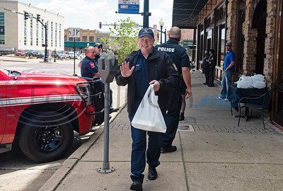 "Tyler area first responders wait outside of Rick's on the Square to receive free meals on Thursday, April 23, 2020. All law enforcement officers and fire department and EMS personnel who showed up wearing a uniform at three Tyler restaurants: Hollytree Country Club, Rick's on the Square and Dakota's, received a free meal sponsored by Tobacco Junction. Tony Cooper, owner of Tobacco Junction said that the free food is a way for Tobacco Junction and the participating eateries to ""show our collective appreciation for the hard work these amazing men and women are doing."""