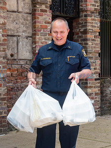 "Kelly Adkinson, Fire Captain with the City of Tyler Fire Department, picks up free meals for his firefighters from Rick's on the Square during a special promotion for Tyler area first responders to receive free meals on Thursday, April 23, 2020. All law enforcement officers and fire department and EMS personnel who showed up wearing a uniform at three Tyler restaurants: Hollytree Country Club, Rick's on the Square and Dakota's, received a free meal sponsored by Tobacco Junction. Tony Cooper, owner of Tobacco Junction said that the free food is a way for Tobacco Junction and the participating eateries to ""show our collective appreciation for the hard work these amazing men and women are doing."""