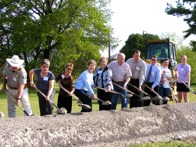 Board members of the Parker County Freedom House take part in the ceremonial ground breaking at the new site of Freedom House's office building.