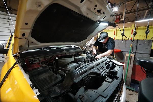BEN GARVER — THE BERKSHIRE EAGLE<br /> Tom  VanBramer works on one of the smaller city plow trucks in the city garage in Pittsfield, Friday, December 6, 2019.