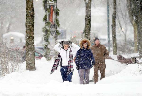 BEN GARVER — THE BERKSHIRE EAGLE<br /> Pedestrians bundle up as the snow begins to fall in Stockbridge, Friday, December 6, 2019.