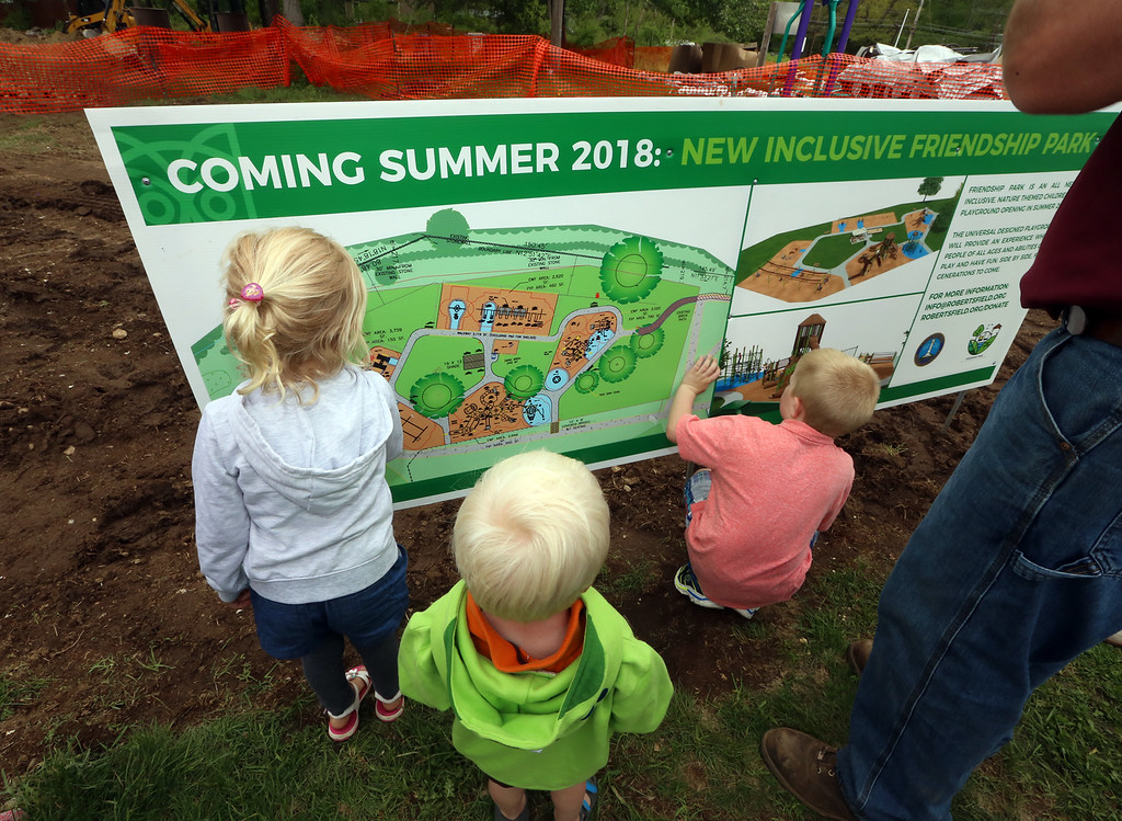 . Groundbreaking for Friendship Park, new playground at Roberts Field in Chelmsford. From left, siblings Brianna, 5, Samuel, 2, and Zachary Lanzillo, 7, who live near Roberts Field and are looking forward to helping build the new playground, check out the plan. (SUN/Julia Malakie)
