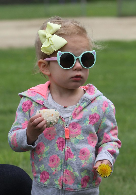 . for Friendship Park, new playground at Roberts Field in Chelmsford. Alanna Dunaj, 5, of Littleton, whose grandmother lives in Chelmsford, enjoys a cookie. (SUN/Julia Malakie)