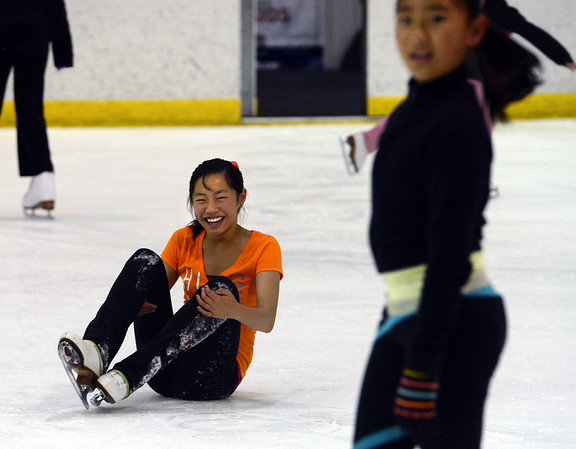 "Angela Li, 11, falls while she practices at the Boulder Valley Ice Rink in Superior on Friday.<br /> For more photos and a video, go to  <a href=""http://www.dailycamera.com"">http://www.dailycamera.com</a>.<br /> Cliff Grassmick / June 8, 2012"