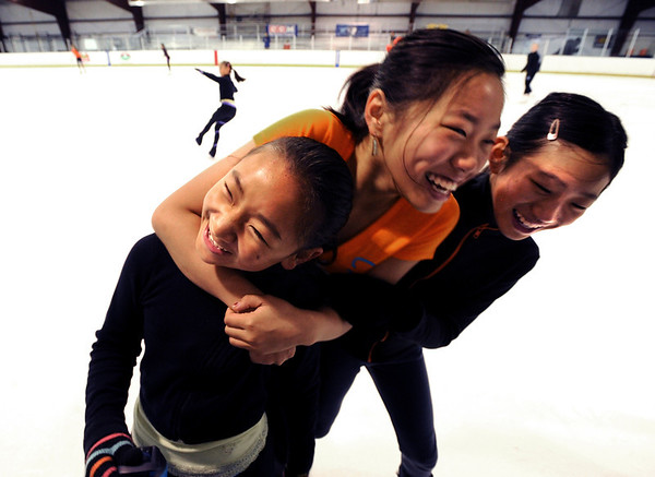"Cynthia Lin, left, Angela Li, and Amanda Li, have some playful fun while ice skating at the Boulder Valley Ice Rink in Superior on Friday.<br /> For more photos and a video, go to  <a href=""http://www.dailycamera.com"">http://www.dailycamera.com</a>.<br /> Cliff Grassmick / June 8, 2012"