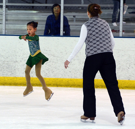 "Catalina Hiller, 7, takes lessons from Lauren Thompson at the Boulder Valley Ice Rink in Superior.<br /> For more photos and a video, go to  <a href=""http://www.dailycamera.com"">http://www.dailycamera.com</a>.<br /> Cliff Grassmick / June 8, 2012"
