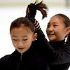 "Amanda Li, left, gets help with her hair from Cynthia Lin at the Boulder Valley Ice Rink in Superior on Friday.<br /> For more photos and a video, go to  <a href=""http://www.dailycamera.com"">http://www.dailycamera.com</a>.<br /> Cliff Grassmick / June 8, 2012"