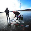 KRISTOPHER RADDER - BRATTLEBORO REFORMER<br /> Bryce Kruas and Bob Pike, of Hinsdale, N.H., prepare a hole in the ice while fishing on the Connecticut River on Monday, Jan. 15, 2018.