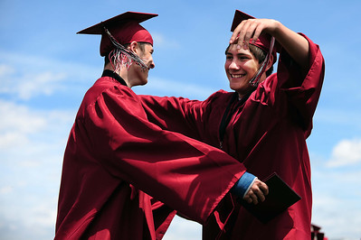20110528_SCHS_6.jpg Nicholas Weyant, left, gets a hug from Anthony Bova after Weyant received his diploma Saturday, May 28, 2011 at Silver Creek High School. (Joshua Buck/Times-Call)