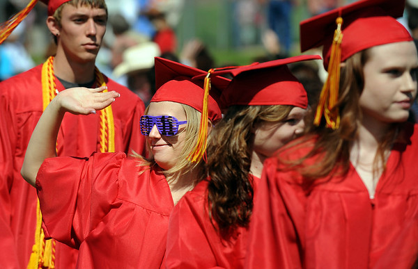 20110528_SHS_GRAD_4.jpg Graduate Tiffany Cooley waves at the beginning of commencement Saturday May 28, 2011 at Skyline High School. (Lewis Geyer/Times-Call)